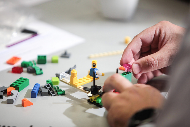 A participant creates a model using Lego